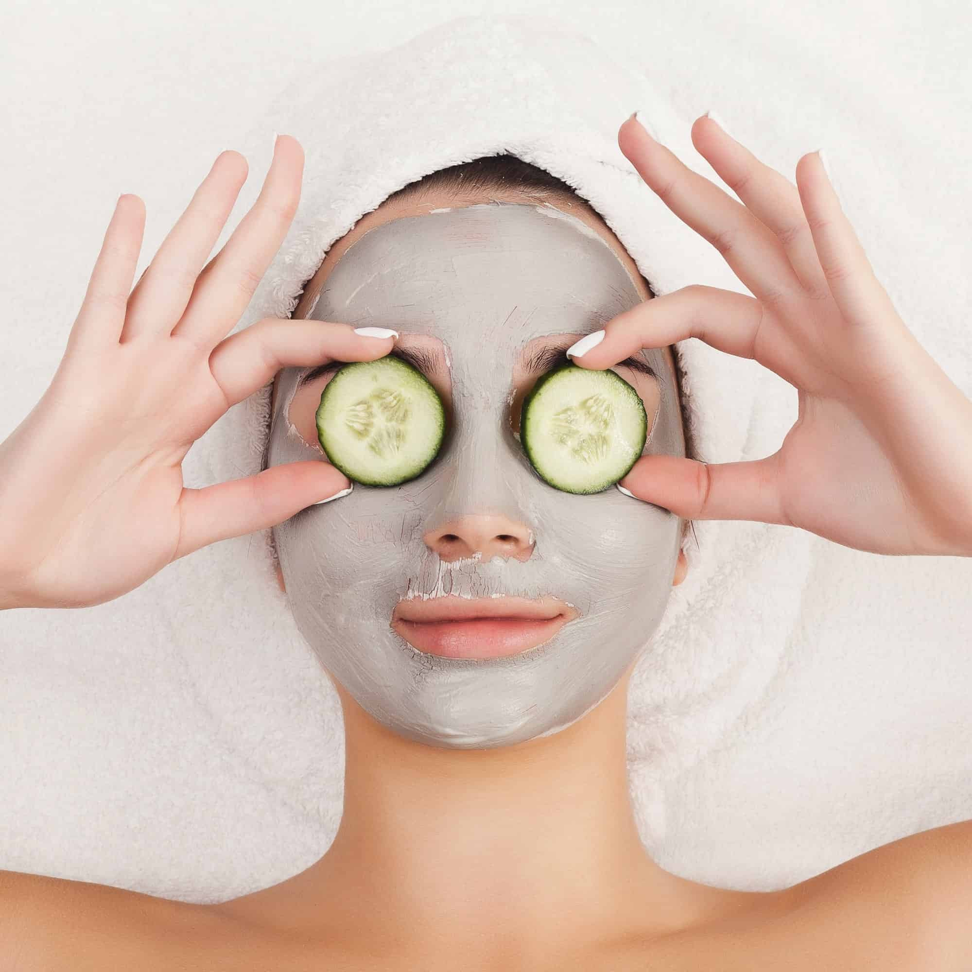 Applying clay mask for oily skin