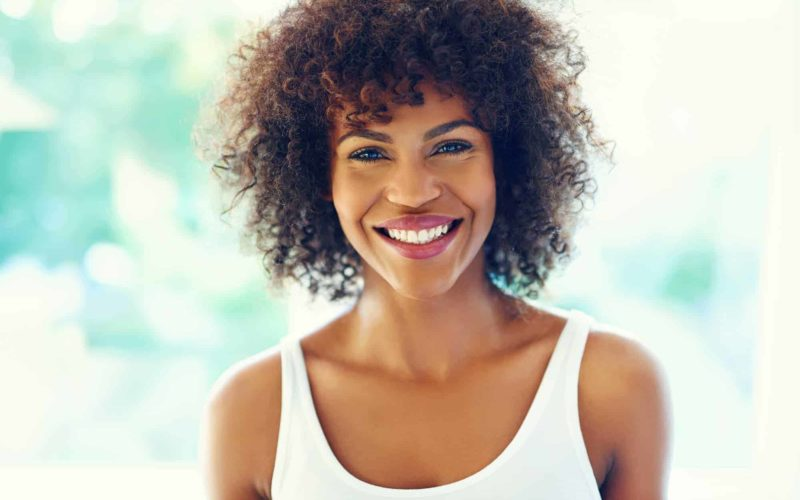 Happy curly natural hair woman