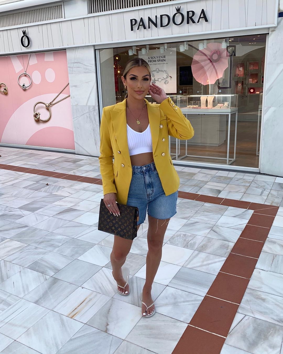 Katerina Themis Keeps Her Denim Shorts Fashion Worthy