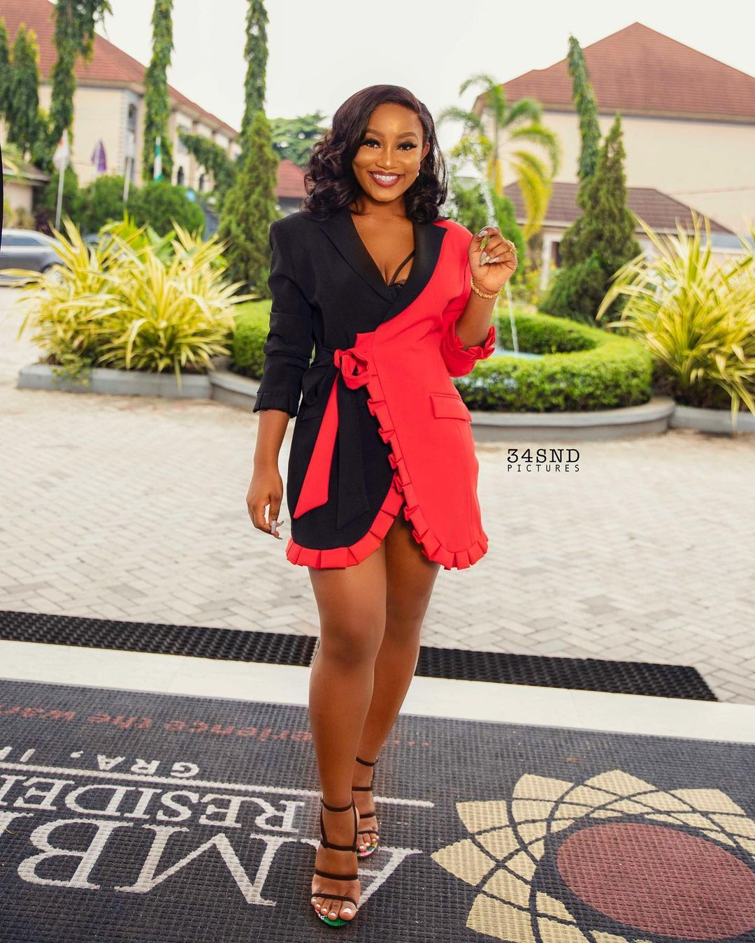 Esther Agunbiade Looking Peng On A Wrap Gown With Decorated Pleate