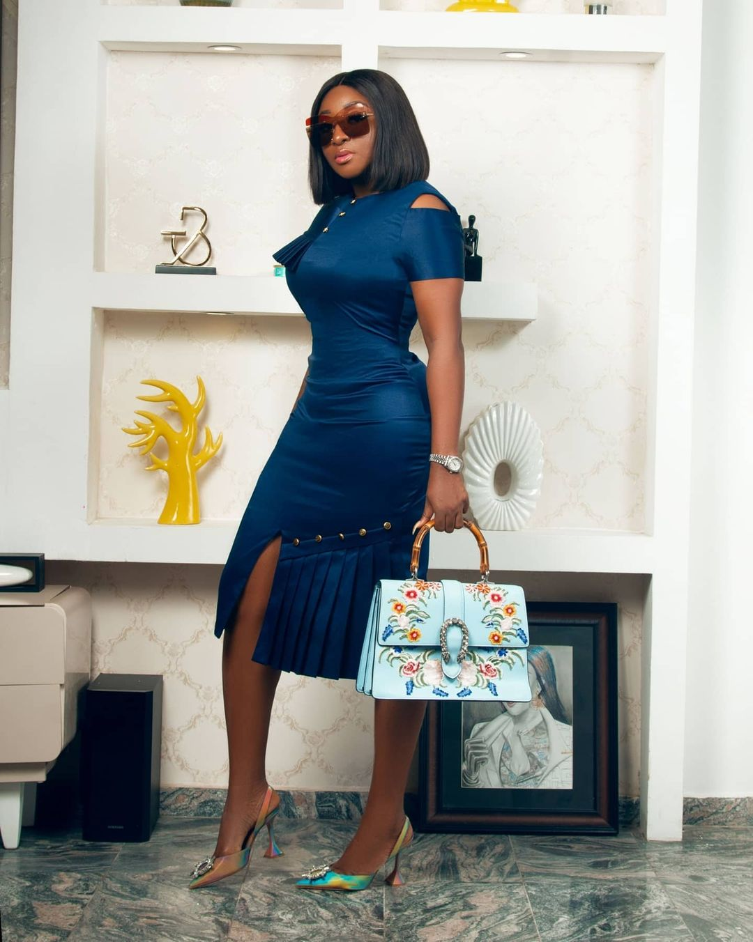 Ini Edo keeping It Classy On Navy Blue Gown With Cold Shoulder