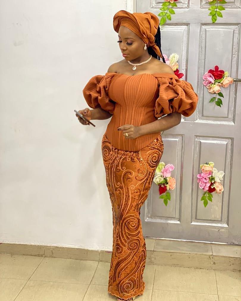 Adeoye Blessing On A Burnt Orange dress
