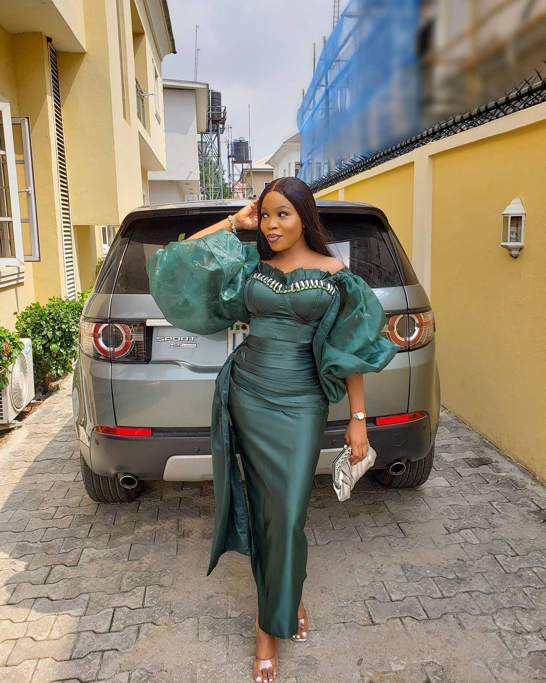 Oluwabusayomi Rocking A Green Dress With Little Twist