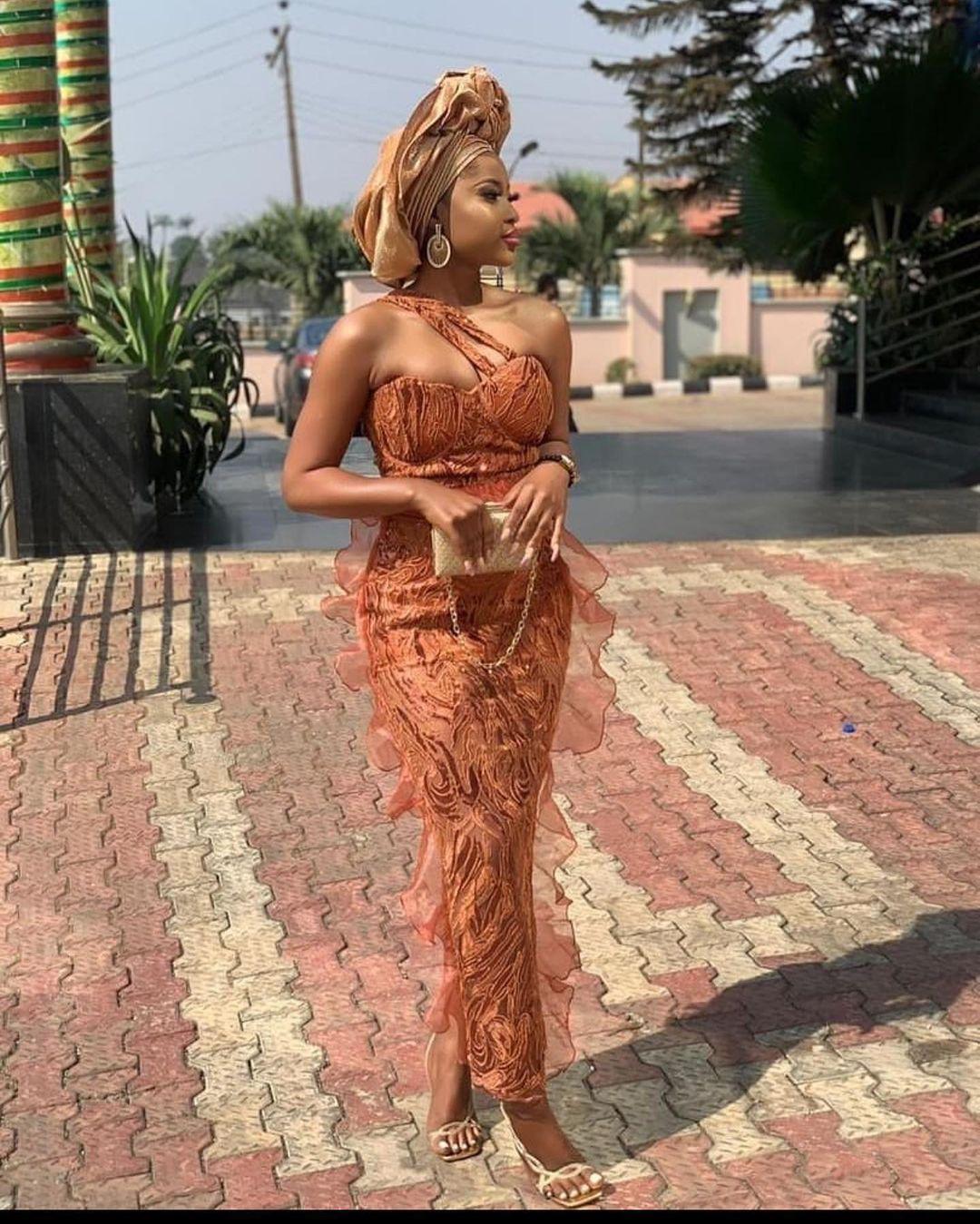 Princess Adeshayo On A Two Strap Neck Line Sleeve