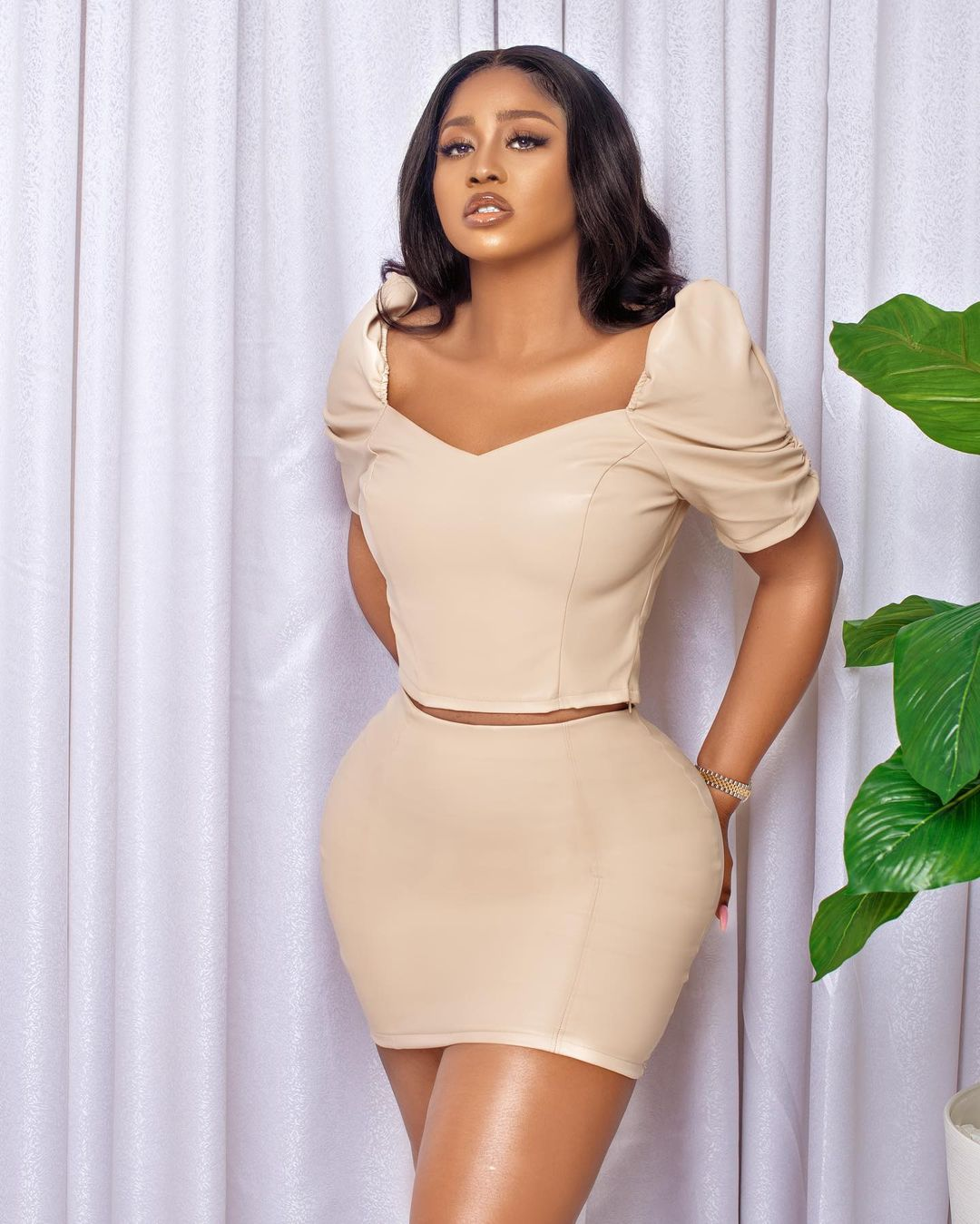 Lilian Afegbai: V-Neck Two Pieces